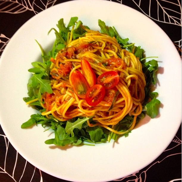 healthyhappyjess Corn Pasta with Zucchini zoodles and tomatoes on top of fresh arugula.